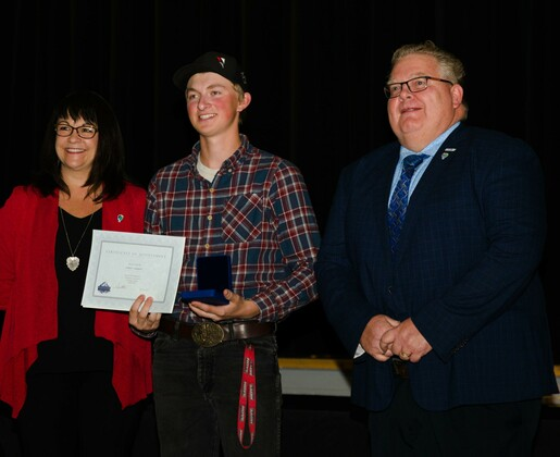 Governor General Award recipient Cody Larsen with Fox Creek Principal Ian Baxter and NGPS Assistant Superintendent Leslee Jodry.